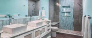 Cleary Company Bathroom Remodels, photo of an updated bathroom with white cabinets and aqua accents