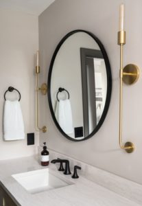 bathroom mirror and gold light sconces